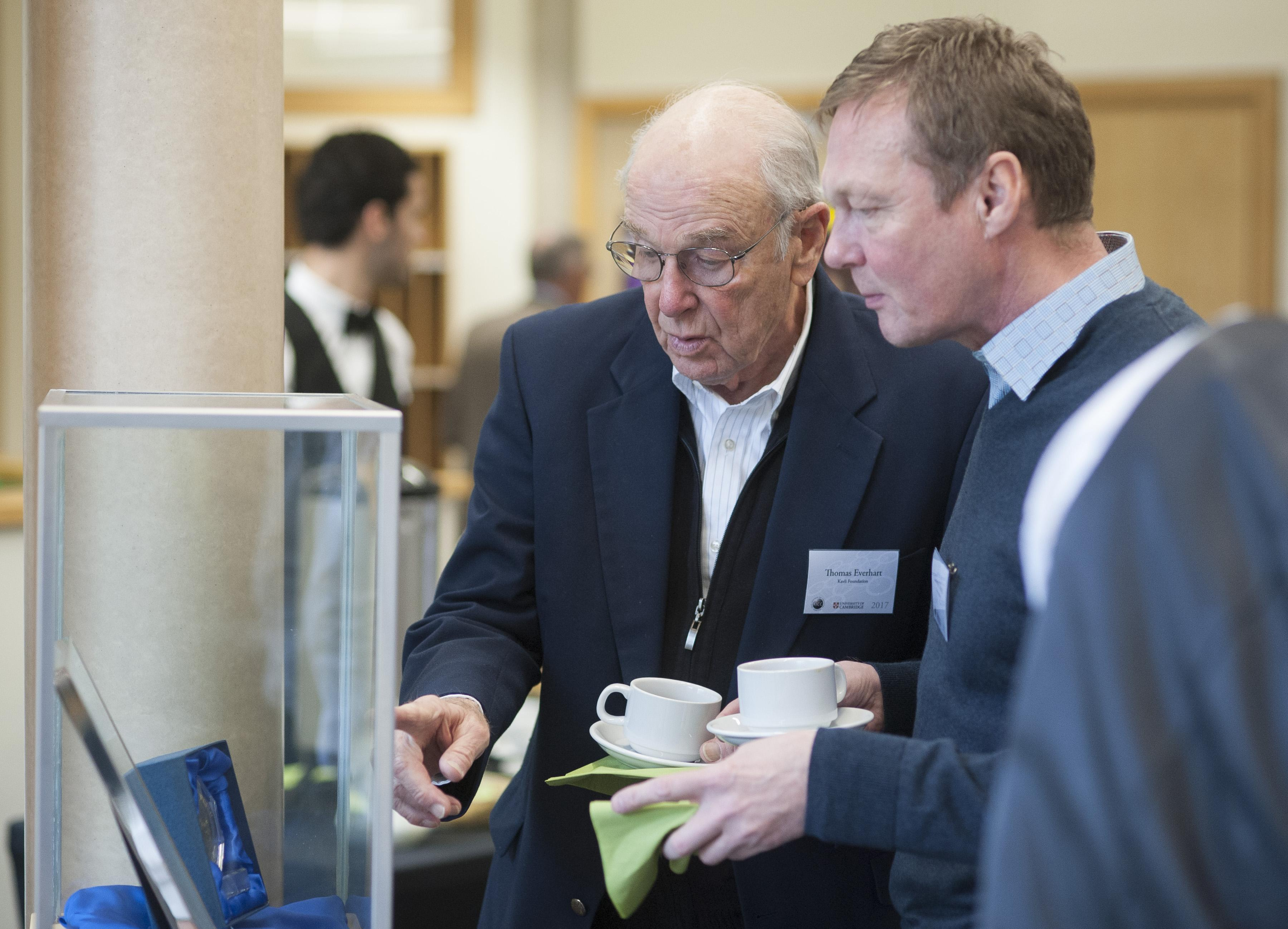 Thomas Everhart and Gunnar Nilsen (Kavli Foundation Directors), looking at Donald Lynden-Bell's Kavli Prize Medal